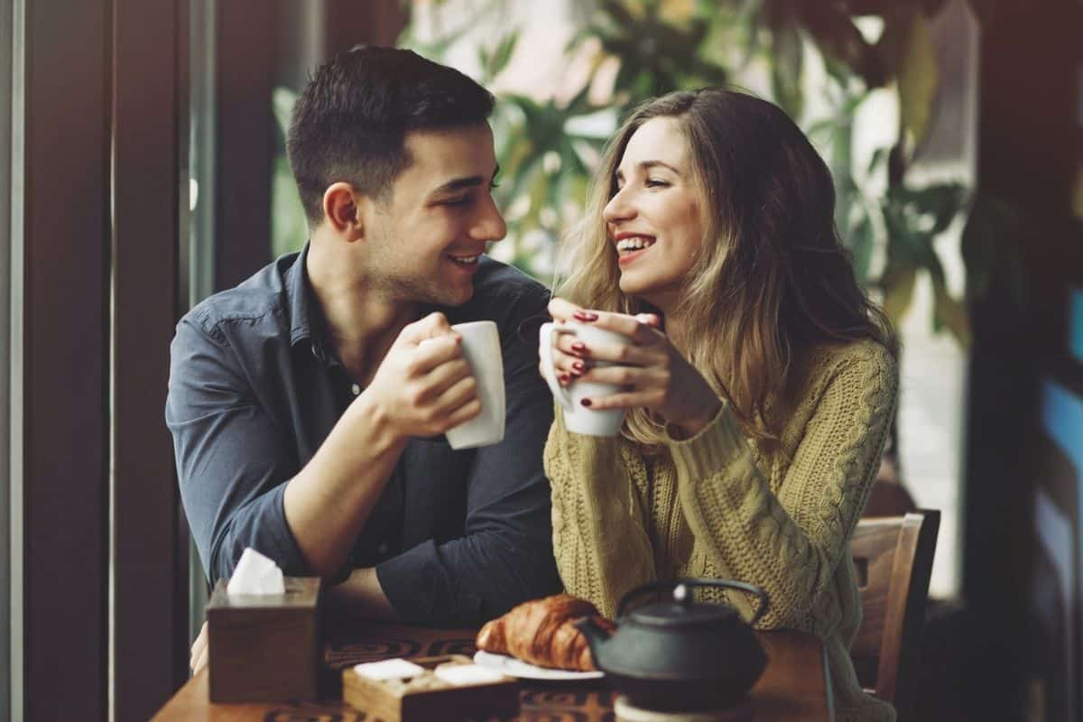 Couple Making and Drinking Coffee at Home.
