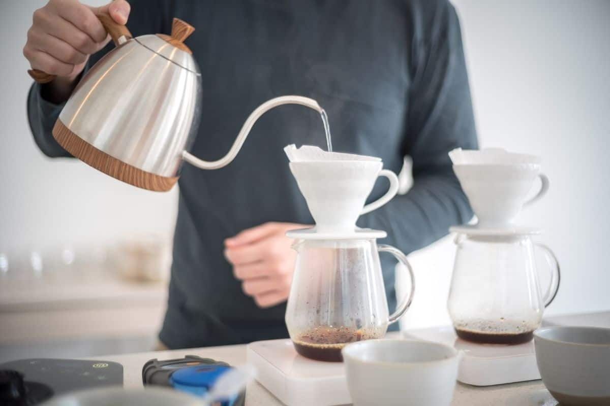 man brewing fresh coffee at home.