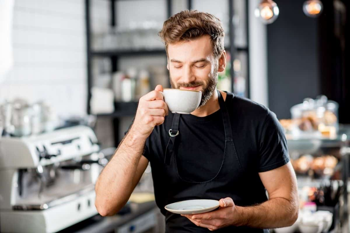 man enjoying a cup of strong black coffee.