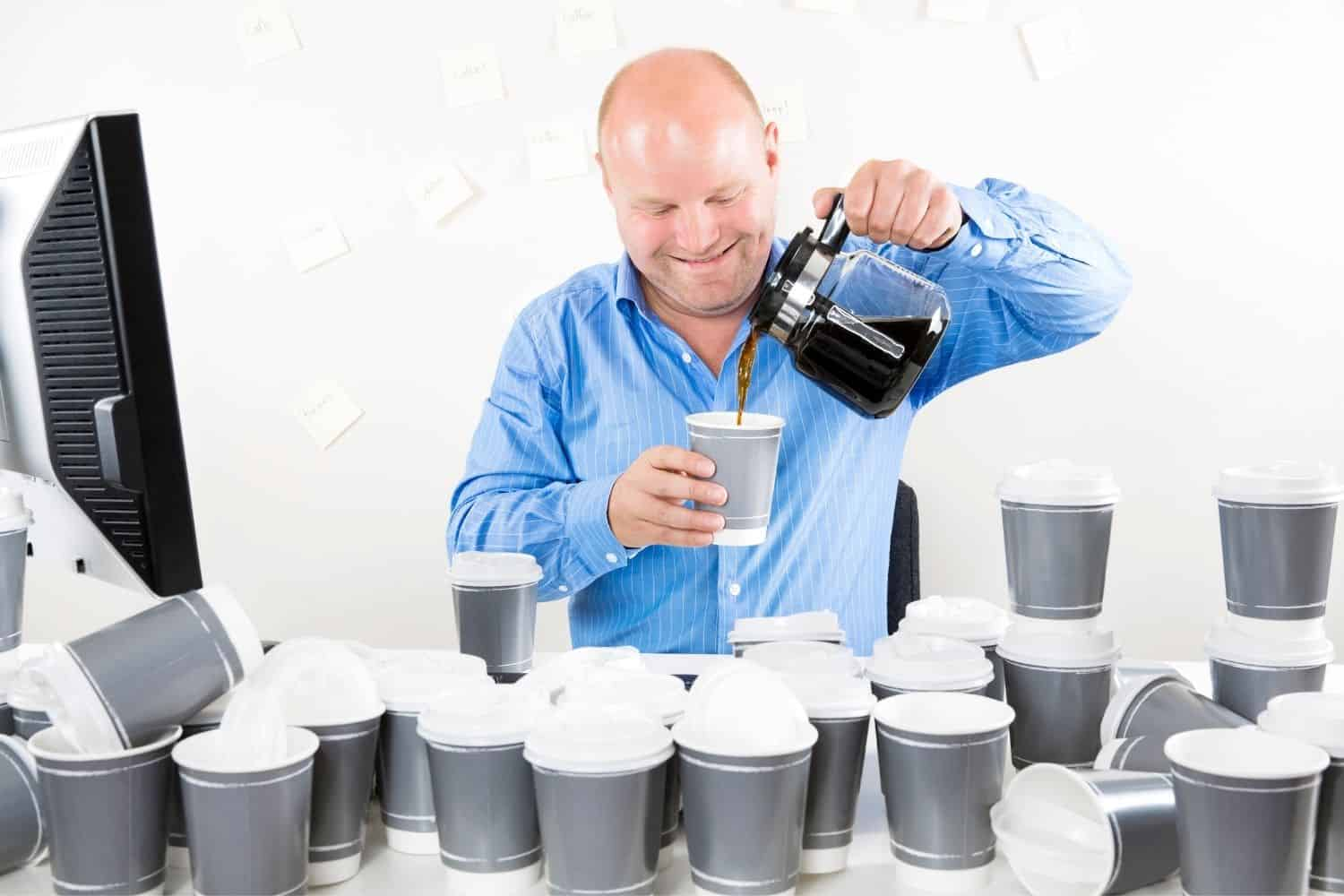 bald man drinking too many cups of coffee.