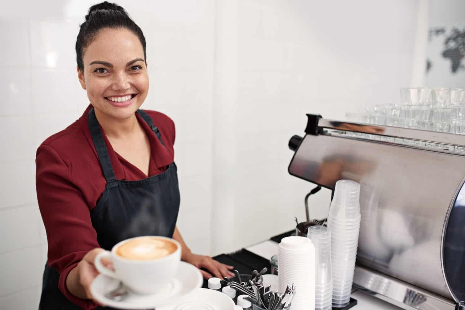 barista serving decaf coffee to a customer.