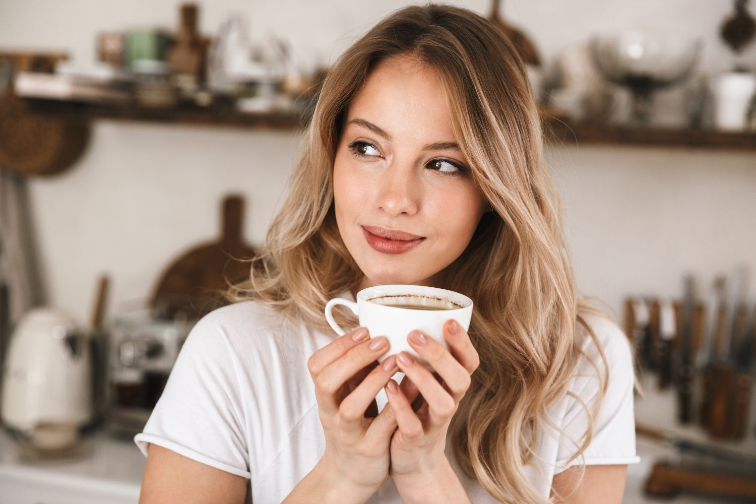 woman drinking coffee that is less acidic.