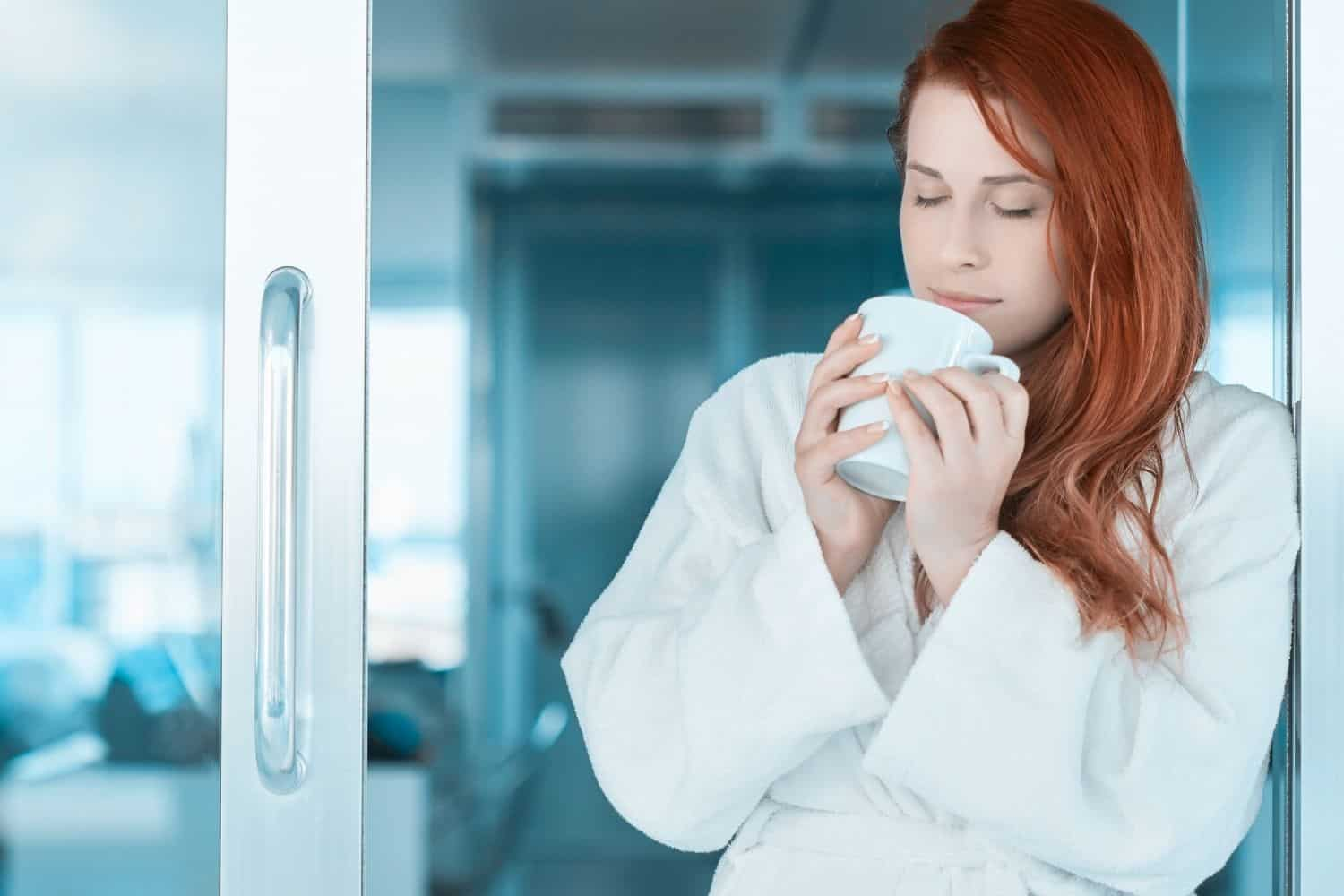 woman smelling her morning cup of coffee.